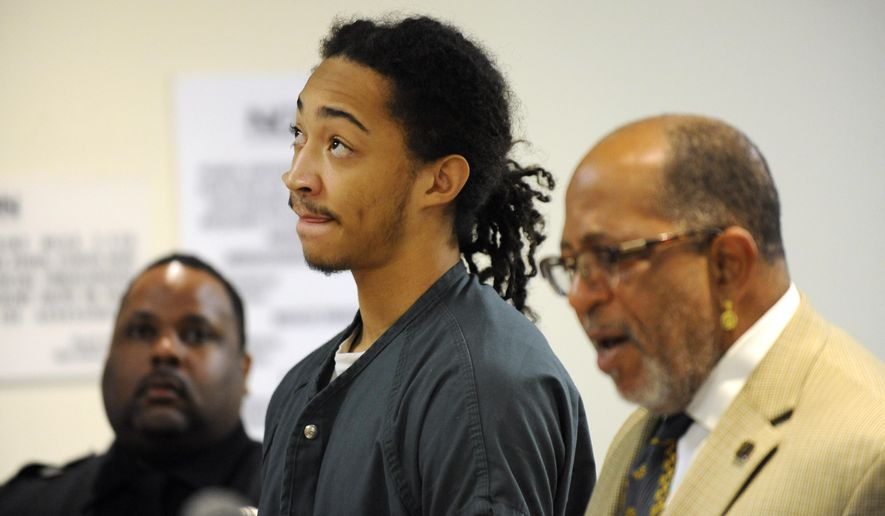 Jayru Campbell and his attorney Jeffrey Edison appear during a hearing at 36th District Court in Detroit, Wednesday, Dec. 17, 2014. The former Detroit prep football star, who pleaded guilty to a misdemeanor charge of domestic violence in connection with an assault on his girlfriend, was sentenced to a year of probation. (AP Photo/Detroit News, David Coates)  DETROIT FREE PRESS OUT; HUFFINGTON POST OUT; MAGS OUT: MANDATORY CREDIT