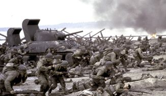 """This photo released by DreamWorks shows a scene form  the 1998 film """"Saving Private Ryan."""" (AP Photo/DreamWorks, David James, File)"""