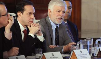 New York environmental conservation commissioner Joseph Martens, right, explains the department's findings on hydraulic fracturing during a cabinet meeting at the Capitol in Albany, N.Y., on Wednesday, Dec. 17, 2014.  At left is acting health commissioner Dr. Howard Zucker.  Gov. Andrew Cuomo's administration will move to prohibit fracking in the state, citing unresolved health issues and dubious economic benefits of the widely used gas-drilling technique.  Martens said that he is recommending a ban. (AP Photo/Tim Roske)