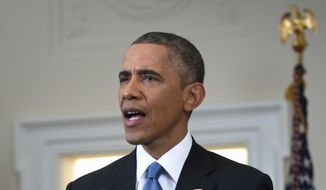 President Obama commuted lengthy prison sentences Wednesday for eight people convicted of drug offenses and issued pardons to 12 other federal convicts. (Associated Press)