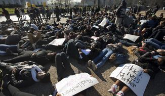 """Students from Washington's """"School without Walls"""" lie down on Pennsylvania Avenue in front of the White House in Washington, Wednesday, Dec. 17, 2014, after walking out of class to participate in a """"die-in.""""  (AP Photo/Pablo Martinez Monsivais) ** FILE **"""