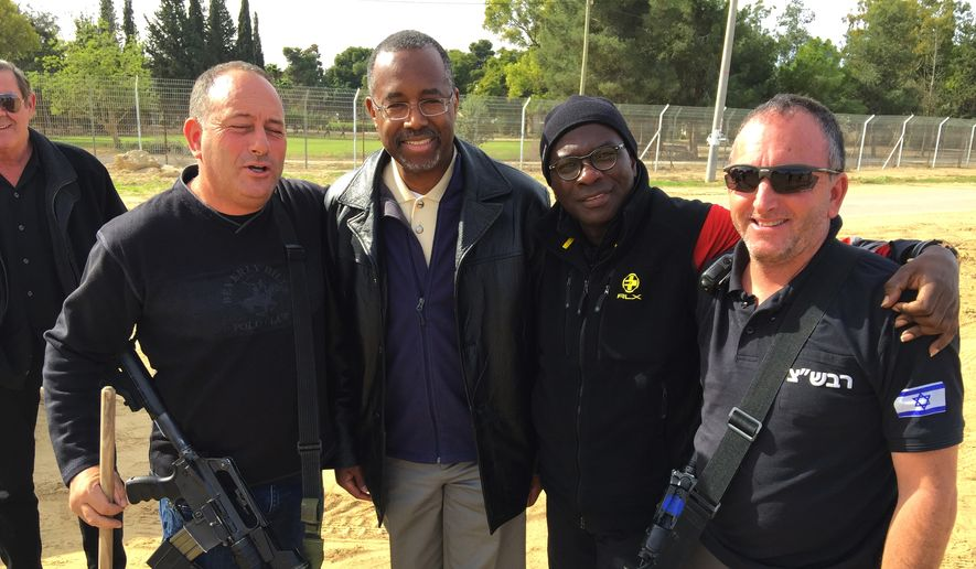 Ben Carson and Armstrong Williams plus a security detail during their eight-day journey to Israel (Photo from Armstrong Williams Productions)