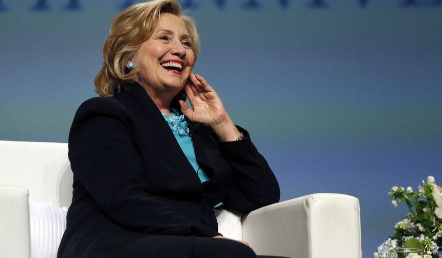 Former Secretary of State Hillary Rodham Clinton has a laugh in Boston in this Dec. 4, 2014, file photo. (AP Photo/Elise Amendola, File)