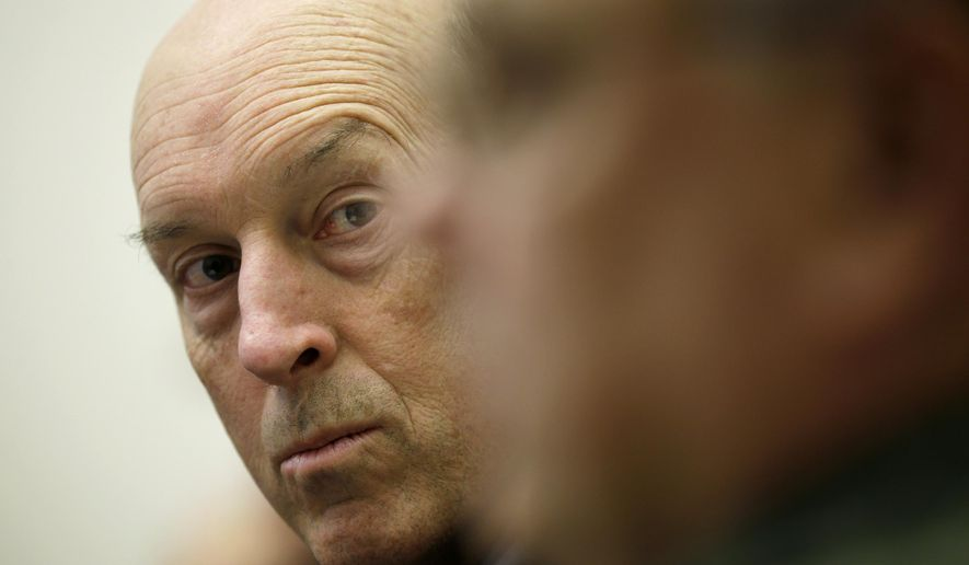 John Selig, director of the Arkansas Department of Human Services, listens during a news conference in Little Rock, Ark., Thursday, Dec. 18, 2014. Federal prosecutors earlier said three women have been charged in a plot to steal money from a food program for the poor. (AP Photo/Danny Johnston)