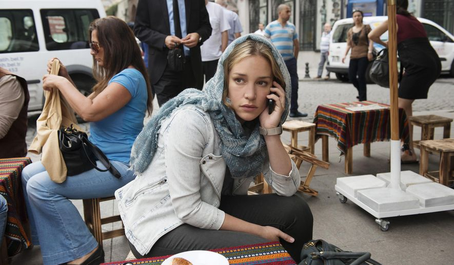 "This photo provided by USA Network shows Piper Perabo as Annie Walker a field agent with the CIA in season 5 of ""Covert Affairs,"" in Istanbul. The series (which airs its fifth season finale Thursday, Dec. 18, 2014, at 10 p.m. EST on USA) has filmed in Medellin, Columbia, Rome, Vienna, Copenhagen, Hong Kong, Paris, Istanbul and Buenos Aires. (AP Photo/USA Network, Monique Jaques)"
