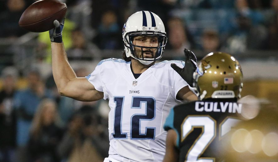 Tennessee Titans quarterback Charlie Whitehurst (12) throws a pass as he is pressured by Jacksonville Jaguars cornerback Aaron Colvin, right, during the first half of an NFL football game in Jacksonville, Fla., Thursday, Dec. 18, 2014. (AP Photo/John Raoux)