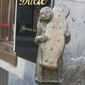 """Statue of girl holding Aachen """"printen"""" (spice bread)   By Corinna Lothar/Special to the Washington Times"""