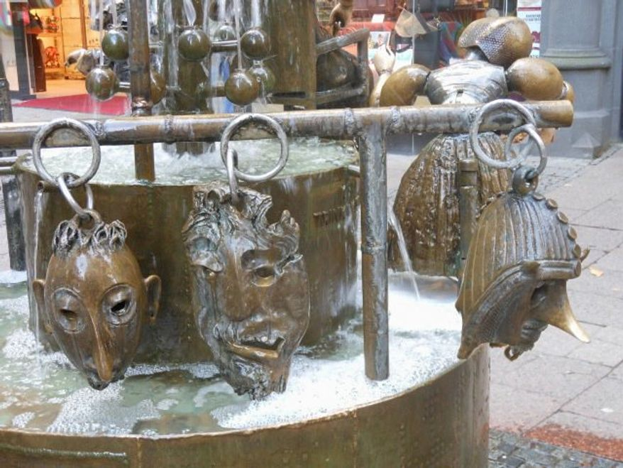 Bronze heads on bottom of Puppet (Doll) Fountain   By Corinna Lothar/Special to the Washington Times