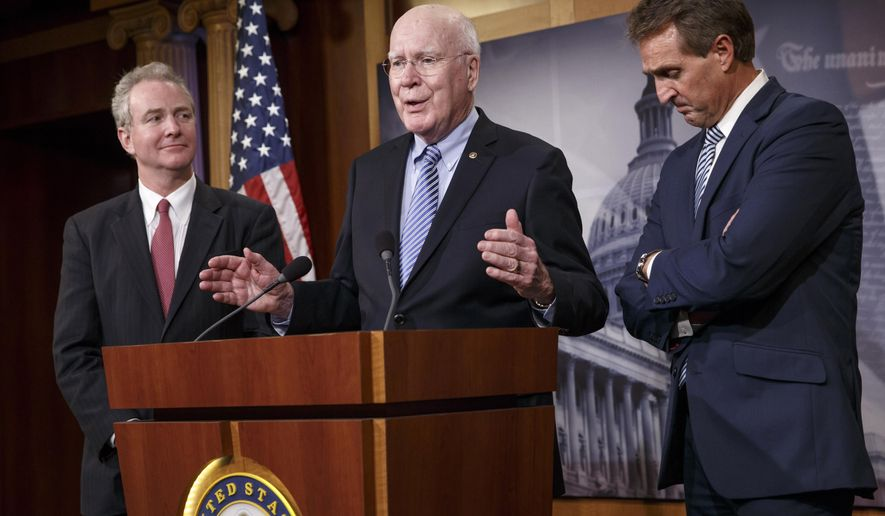 From left, Rep. Chris Van Hollen, D-Md., Sen. Patrick Leahy, D-Vt., and Sen. Jeff Flake, R-Ariz., participate in a news conference on Capitol Hill in Washington, Wednesday, Dec. 17, 2014, after traveling to Havana earlier today to bring back American prisoner Alan Gross who has been held by the Cuban government. President Barack Obama announced that the United States and Cuba have agreed to re-establish diplomatic relations and open economic and travel ties, marking a historic shift in U.S. policy toward the communist island after a half-century of enmity dating back to the Cold War. (AP Photo/J. Scott Applewhite)