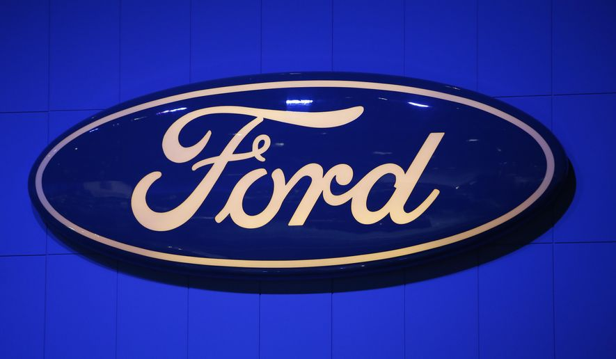 FILE - This Thursday, Nov. 29, 2012, file photo, shows the company's logo at the LA Auto Show in Los Angeles. Ford says it's expanding a recall for faulty driver's side air bag inflators to the entire U.S. as demanded by the government. The move adds 447,000 Ford vehicles to the list of those recalled due to driver's inflators made by Japan's Takata Corp. The inflators can explode with too much force, spewing shrapnel into drivers and passengers. (AP Photo/Jae C. Hong, File)