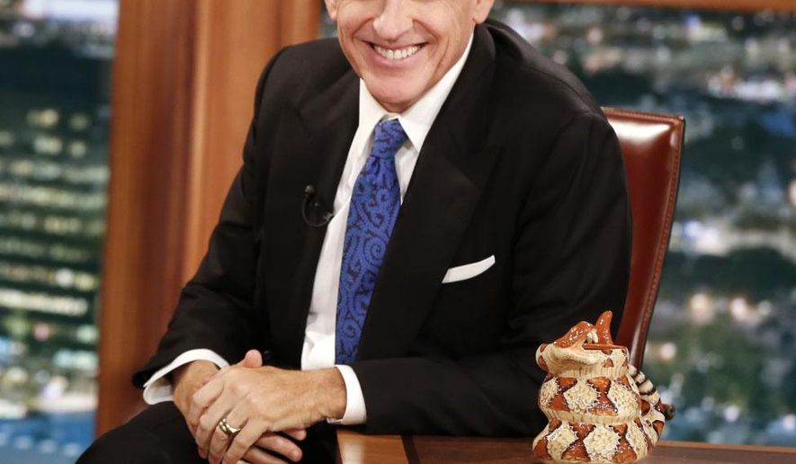 "In this Dec. 15, 2014 photo released by CBS, host Craig Ferguson appears on the set of ""The Late Late Show with Craig Ferguson,"" in Los Angeles. Ferguson's final show will be on Friday. (AP Photo/CBS, Monty Brinton)"