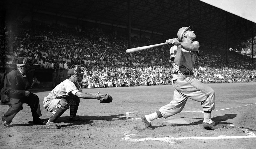 FILE - In this Feb. 5, 1946 file photo, Dick Sisler watches his hit during a winter baseball league game in Havana, Cuba. Sisler, the son of the all time great first baseman George Sisler, was the new batting sensation who was headed for his first major league with the St. Louis Cardinals. The Wednesday, Dec. 17, 2014 announcement that the U.S. plans to restore diplomatic ties with the Caribbean nation could usher in a new era in U.S.-Cuba baseball relations, which were strained after the Castro revolution and the U.S.-led economic embargo.  (AP Photo, File)