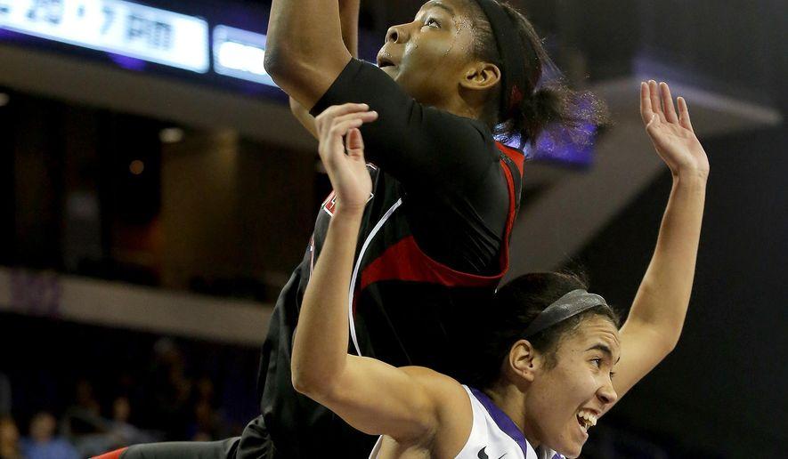 Louisville forward Myisha Hines-Allen shoots over Grand Canyon guard August Touchard during the first half of an NCAA college basketball game, Thursday, Dec. 18, 2014, in Phoenix. (AP Photo/Rick Scuteri)