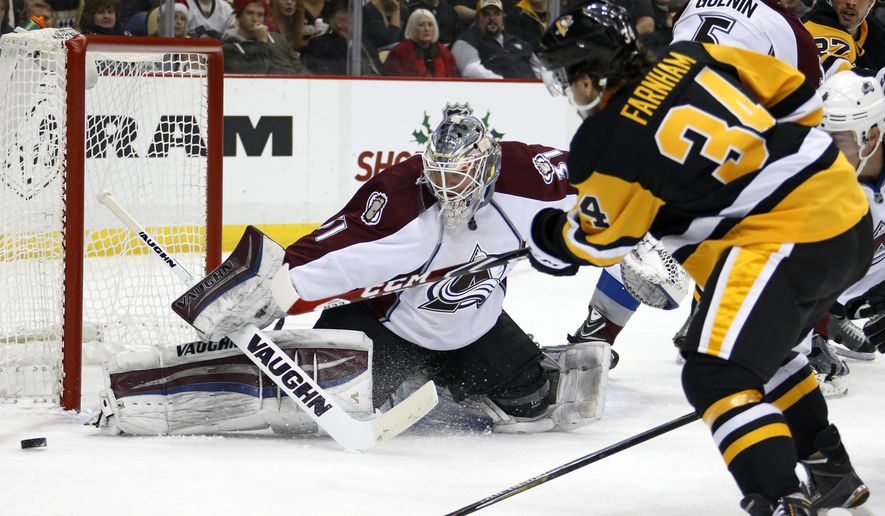 Colorado Avalanche goalie Calvin Pickard turns away a shot by Pittsburgh Penguins' Bobby Farnham (34) during the second period of an NHL hockey game in Pittsburgh on Thursday, Dec. 18, 2014. (AP Photo/Gene J. Puskar)