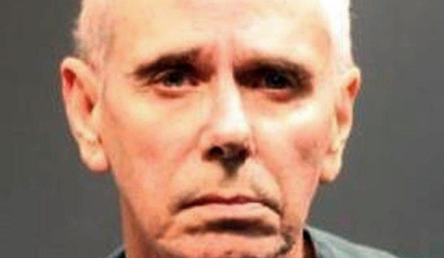 This undated photo from the Santa Ana, Calif., Police Department shows Douglas Gutridge. Gutridge, 63, has been charged with the 1989 stabbing death of a 35-year-old woman in Orange County, Calif., after a new cold case team re-examined the killing, officials said Thursday, Dec. 18, 2014. Gutridge was arrested last week. He was charged with one count of murder and is being held on $1 million bail, the Orange County district attorney's office said. Prosecutors say Gutridge killed 35-year-old Carla Salazar inside her Santa Ana apartment in June 1989. The arrest came after a newly created cold case homicide task force took over the investigation in July.(AP Photo/Santa Ana Police Department)