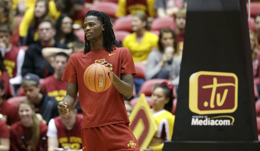 In this Dec. 14, 2014, photo Iowa State forward Jameel McKay stands on the court before an NCAA college basketball game against Southern University in Ames, Iowa. McKay, who transferred to Iowa State from Marquette, becomes eligible to play when Iowa State faces Drake on Saturday in Des Moines, Iowa. (AP Photo/Charlie Neibergall)