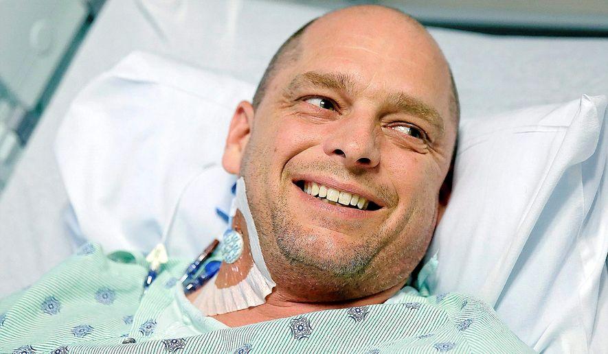Paul Kropp talks about his kidney transplant at Integris Baptist Medical Center in Oklahoma City, Thursday, Dec. 17, 2014. Chris Kelley, an acquaintance, donated Kropp a kidney. (AP Photo/Tulsa World, Mike Simon)  ONLINE OUT; KOTV OUT; KJRH OUT; KTUL OUT; KOKI OUT; KQCW OUT; KDOR OUT; TULSA OUT; TULSA ONLINE OUT