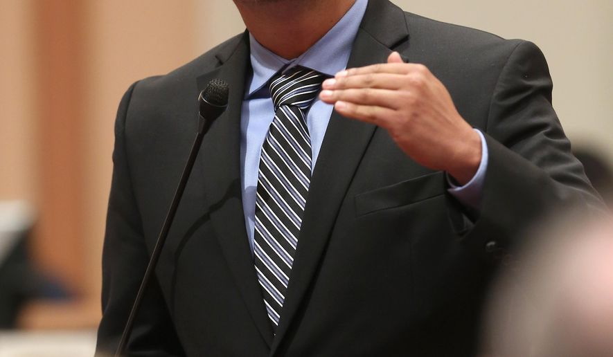FILE - In this photo taken Monday, Aug. 18, 2014, is state Sen. Ben Hueso, D-San Diego, who pleaded no contest to the lessor charge of alcholol-related reckless driving, in Sacramento County Superior Court, Thursday, Dec. 18, 2014. Hueso, seen speaking before lawmakers at the Capitol,  was arrested in Sacramento,  on suspicion of drunken driving and driving with a blood alcohol content of 0.08 percent or more last August.(AP Photo/Rich Pedroncelli)