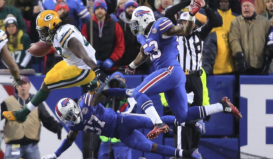 Buffalo Bills  Nigel Bradham (53) and  Nickell Robey (37) tackle Green Bay Packer Eddie Lacy for a saftey  during the second half at Ralph WIlson Stadium on Sunday, Dec. 14, 2014,  in Orchard Park, NY. (AP Photo/The Buffalo News, Harry Schull, Jr.)  TV OUT; MAGS OUT; MANDATORY CREDIT; BATAVIA DAILY NEWS OUT; DUNKIRK OBSERVER OUT; JAMESTOWN POST-JOURNAL OUT; LOCKPORT UNION-SUN JOURNAL OUT; NIAGARA GAZETTE OUT; OLEAN TIMES-HERALD OUT; SALAMANCA PRESS OUT; TONAWANDA NEWS OUT