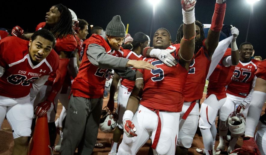 Jarrod Lacey (5) joins teammates in celebration on Saturday, Dec. 13, 2014 in Pueblo, Colo. after Colorado State University-Pueblo defeated University of West Georgia 10-7 NCAA college football game to advance to the Division II national championship. (AP Photo/The Pueblo Chieftain, Chris McLean)
