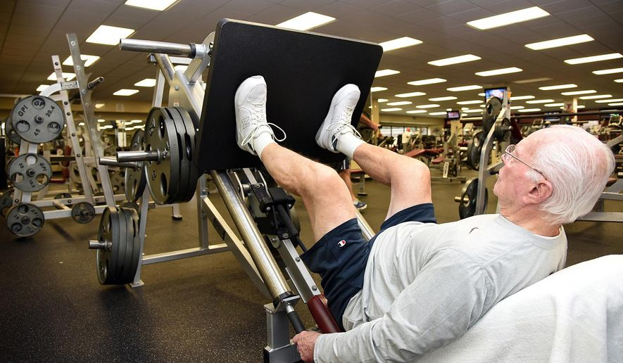 ADVANCE FOR USE SUNDAY, DEC. 21 - In this photo taken on Dec. 2, 2014, Clarence Ilderton does leg presses at the YMCA in High Point, N.C. Ilderton, 88, works out every Monday, Tuesday, Thursday, Friday and, sometimes, Saturday.  (AP Photo/The Enterprise, Laura Greene)