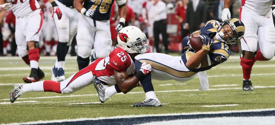 St. Louis Rams wide receiver Stedman Bailey stretches towards the end zone as he is tackled at the one-yard line by Arizona Cardinals cornerback Jerraud Powers in the fourth quarter of an NFL football game, Thursday, Dec. 11, 2014 in St. Louis. Arizona won 12-6. (AP Photo/St. Louis Post-Dispatch, Chris Lee)  EDWARDSVILLE INTELLIGENCER OUT; THE ALTON TELEGRAPH OUT