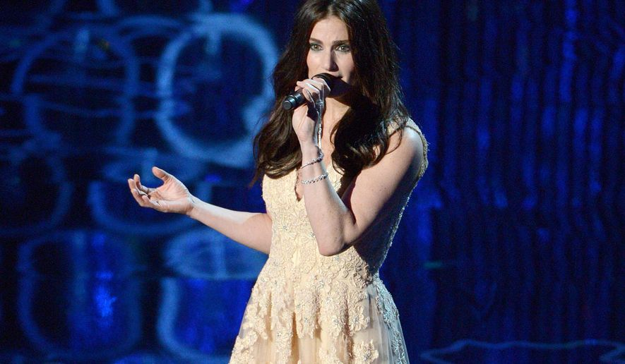 "FILE - This March 2, 2014 file photo shows Idina Menzel performing during the Oscars at the Dolby Theatre in Los Angeles. John Travolta accidentally introduced her as ""Adele Dazeem"" right before she was about to sing the hit song ""Let It Go,"" from the animated film, ""Frozen."" (Photo by John Shearer/Invision/AP, File)"