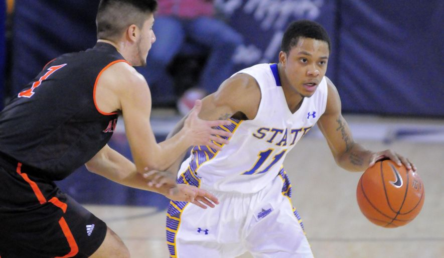 South Dakota State guard George Marshall (11) dribbles the ball as Idaho State guard Geno Luzcando (1) defends during an NCAA college basketball game Thursday Dec. 18, 2014, in Logan, Utah. (AP Photo/The Herald Journal, Eli Lucero)