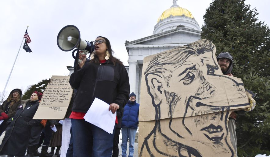 Demonstrators gathered on the steps of the Statehouse in Montpelier, Vt., Thursday, Dec. 18, 2014, for a rally in favor of single-payer health care, in the wake of Gov. Peter Shumlin's decision the day before to pull the plug on single-payer plan in state. (AP Photo/The Burlington Free Press, Glenn Russell) NO SALES, MAGS OUT, TV OUT, ONLINE OUT, MANDATORY CREDIT