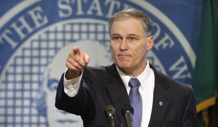 Washington state Gov. Jay Inslee takes a question as he introduces his 2015-17 budget proposal in the Governor's Conference Room at the Capitol in Olympia on Thursday, Dec. 18, 2014. (AP Photo/The Olympian, Tony Overman)
