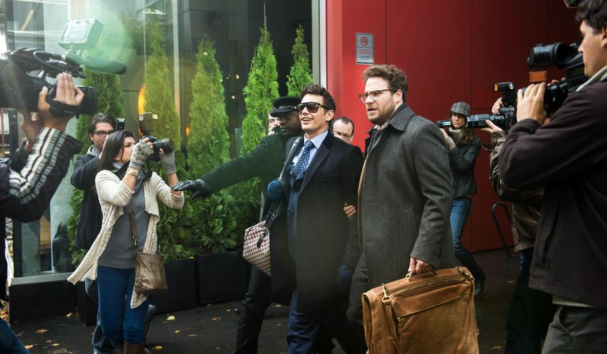 "This photo provided by Columbia Pictures - Sony shows, James Franco, center left, as Dave, and Seth Rogen as Aaron, in Columbia Pictures' ""The Interview."" (AP Photo/Columbia Pictures - Sony, Ed Araquel)"