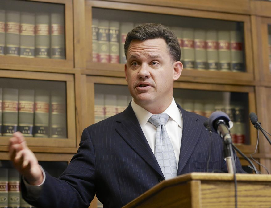 Nebraska Attorney General Jon Bruning speaks at a news conference in Lincoln, Neb. on Thursday, Dec. 18, 2014 annoucing that he and Oklahoma Attorney General Scott Pruitt are filing a lawsuit in the U.S. Supreme Court seeking a declaration that Colorado's legalization of marijuana violates the U.S. Constitution. (AP Photo/Nati Harnik)