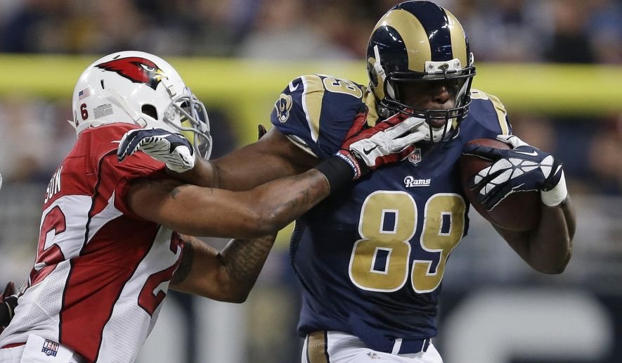 St. Louis Rams' Jared Cook (89) is tackled by Arizona Cardinals' Rashad Johnson (26) during the second half of an NFL football game Thursday, Dec. 11, 2014 in St. Louis. (AP Photo/Jeff Roberson)