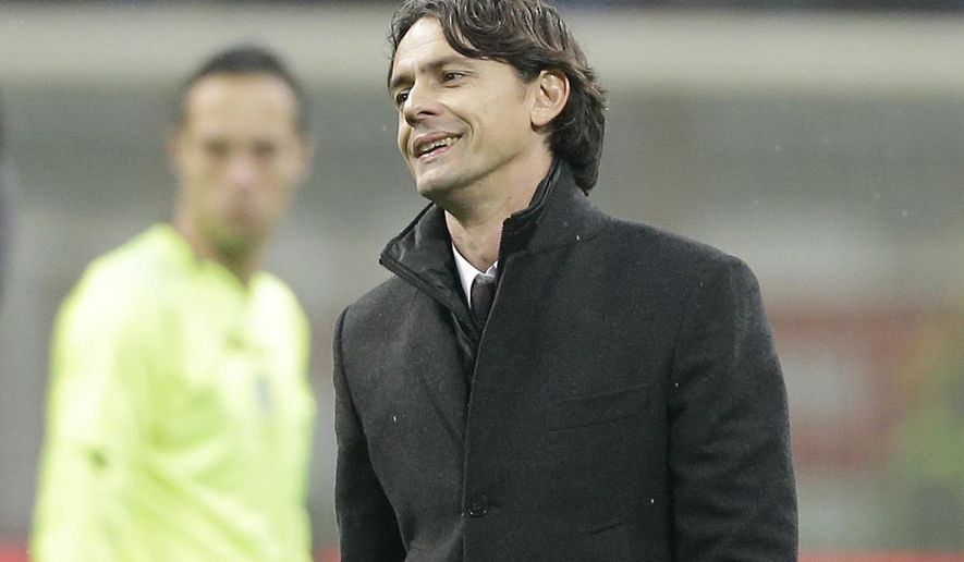 AC Milan coach Filippo Inzaghi smiles at the end of a Serie A soccer match between AC Milan and Napoli at the San Siro stadium in Milan, Italy, Sunday, Dec. 14, 2014. AC Milan beat Napoli 2-0 at the San Siro with goals from Jeremy Menez and Giacomo Bonaventura. (AP Photo/Antonio Calanni)