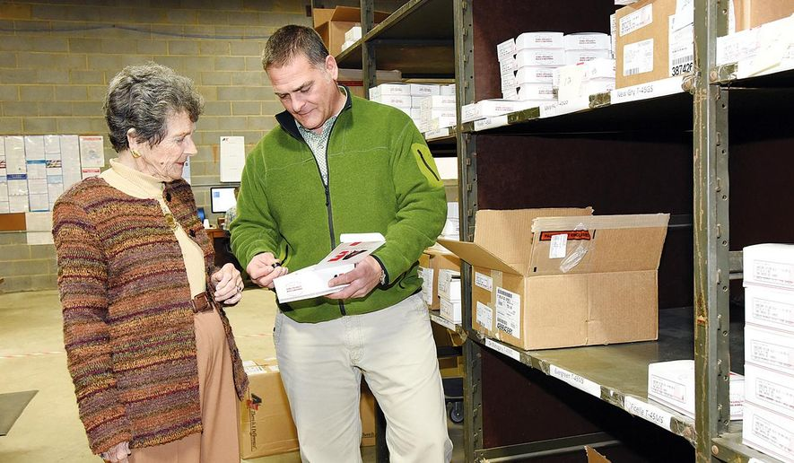 In this photo taken on  Dec. 8, 2014, Mike Oliver, third-generation president of Arthur A. Oliver & Son, Inc., looks over furniture supplies with his mother and former company president Lee Oliver, in High Point, N.C. The High Point business is celebrating its 90th anniversary this year.  (AP Photo/The Enterprise, Laura Greene )