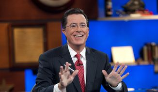 "This Sept. 8, 2010, publicity photo released by Comedy Central shows host Stephen Colbert appears on ""The Colbert Report,"" in New York. ""The Colbert Report"" will end on Thursday, Dec. 18, 2014, after nine seasons. (AP Photo/Comedy Central, Scott Gries)"