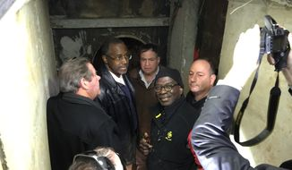 Dr. Ben Carson, second from left, and Armstrong Williams, second from right, inspect secret tunnels used by Hamas terrorists to infiltrate from the Gaza Strip into Israel.