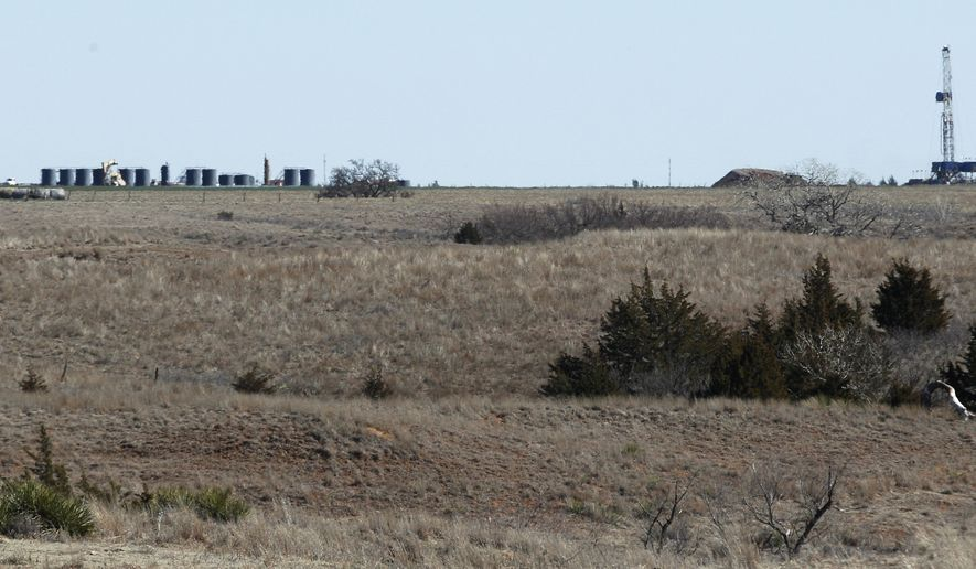 In this Feb. 21, 2012 file photo, an oil drilling rig drill into the Gypsum Hills near Medicine Lodge, Kan. Plunging crude prices are hitting oil producers especially hard in places like Kansas, where the industry is dominated by smaller, independent operators who depend more heavily on the cash flow from producing wells to pay for drilling new ones. (AP Photo/Orlin Wagner, File)