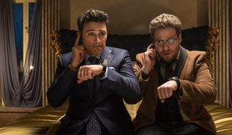 """This image released by Columbia Pictures - Sony shows James Franco, left, and Seth Rogen in """"The Interview.""""  Sony Pictures canceled all release plans for the film at the heart of the hacking scandal that exposed tens of thousands of sensitive documents and escalated to threats of terrorist attacks.   (AP Photo/Columbia Pictures, Sony, Ed Araquel)"""