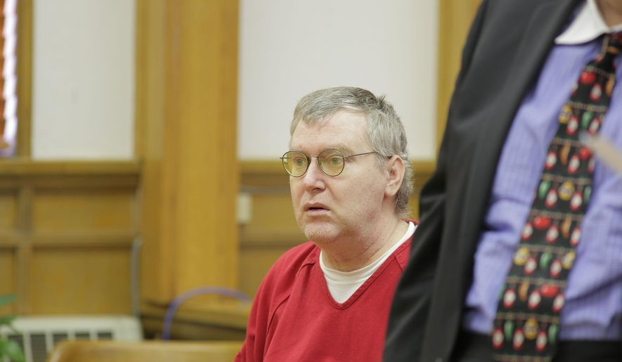 In this photo taken on Thursday, Dec. 18, 2014, Kelly Rhyne listens during a plea hearing in Elko District Court in Elko, Nev. Rhyne, sentenced to death for a 1998 murder, was issued a new sentence Thursday, that gives him credit for 16 years of time served and makes him eligible for parole immediately.  (AP Photo/The Daily Free Press, , Ross Andreson)