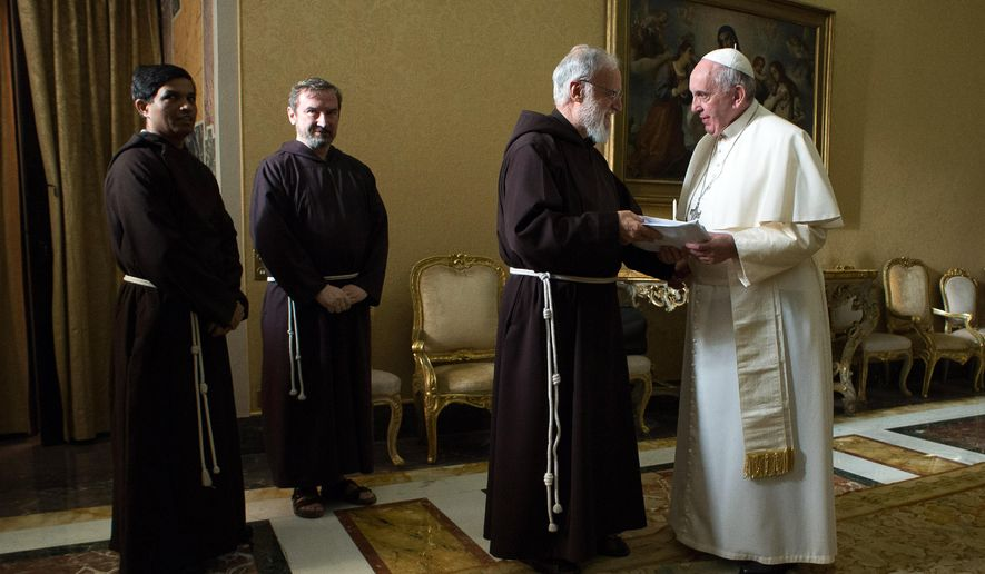In this photo provided by Vatican newspaper L'Osservatore Romano, Pope Francis talks to Franciscan Capuchin preacher father Raniero Cantalamessa, at the Vatican, Friday, Dec. 19, 2014. (AP Photo/L'Osservatore Romano)