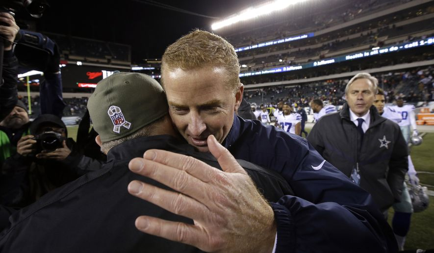 Dallas Cowboys head coach Jason Garrett, right, hugs Philadelphia Eagles head coach Chip Kelly after an NFL football game, Sunday, Dec. 14, 2014, in Philadelphia. Dallas won 38-27. (AP Photo/Matt Rourke)