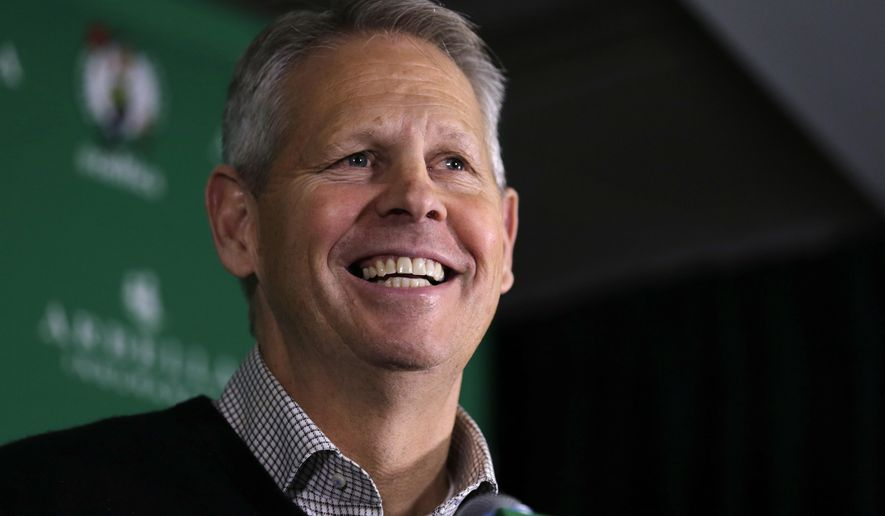 Danny Ainge, Boston Celtics president of basketball operations, smiles as he discusses  the trade of point guard Rajon Rondo prior to an NBA basketball game in Boston, Friday, Dec. 19, 2014. The Celtics traded Rondo to Dallas on Thursday night, Dec. 18, 2014, cutting ties with the last remnant of Boston's last NBA championship while giving Dirk Nowitzki and the Mavericks a chance at another title. (AP Photo/Charles Krupa)