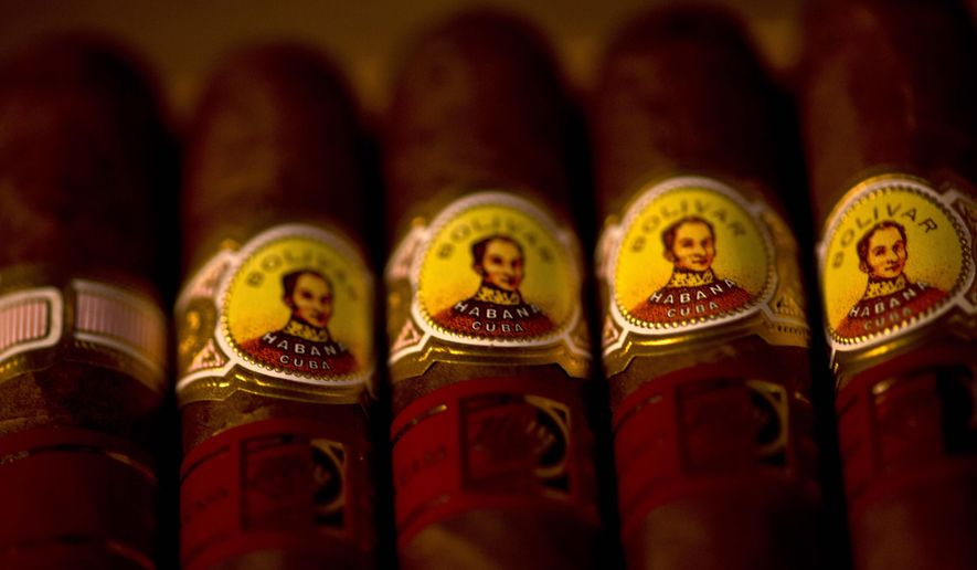 Samples of Bolivar cigars sit on display at a cigar club shop in Havana, Cuba, Friday, Dec. 19, 2014. The Cuban cigar is set to make its first legal appearance in the United States in years, with relaxed guidelines allowing travelers to return with a few of the once-forbidden items in their suitcases. (AP Photo/Ramon Espinosa)