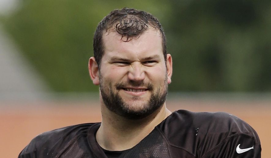FILE - This is an Aug. 12, 2014, file photo showing Cleveland Browns tackle Joe Thomas at NFL football training camp in Berea, Ohio. Wisconsin officials have accused Cleveland Browns lineman Joe Thomas of multiple environmental violations on his hunting land west of Madison. The state Department of Natural Resources sent the former Wisconsin Badgers standout a letter Wednesday, Dec. 17, 2014,  accusing him of doing work on the land without permits, including building bridges and dams and dredging a pond.(AP Photo/Mark Duncan, File)