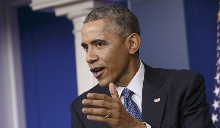President Barack Obama speaks during a news conference in the Brady Press Briefing Room of the White House in Washington, Friday, Dec. 19, 2014. The president claimed an array of successes in 2014, citing lower unemployment, a rising number of Americans covered by health insurance, and an historic diplomatic opening with Cuba. He also touts his own executive action and a Chinese agreement to combat global warming. (AP Photo/J. Scott Applewhite)