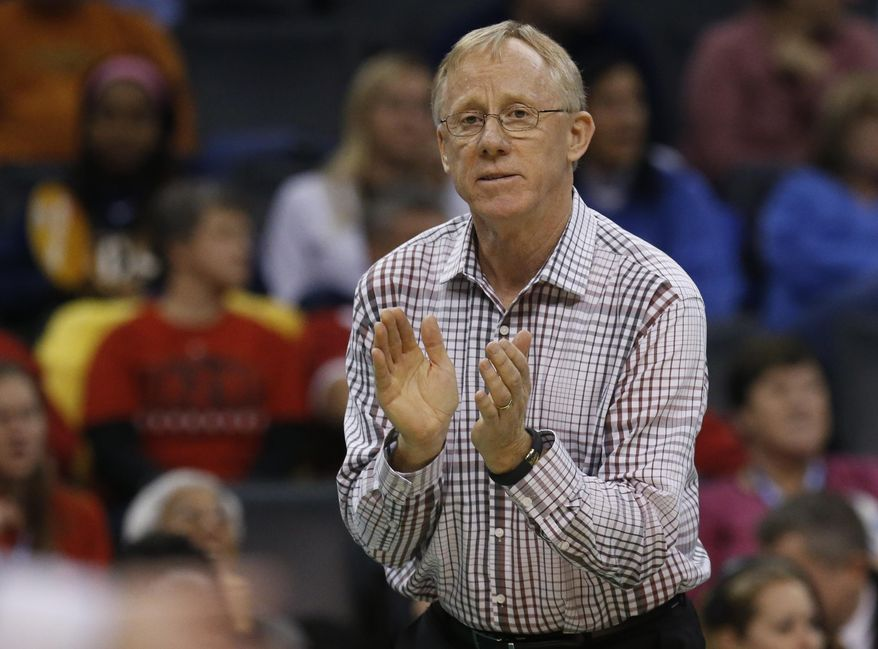 Stanford head coach John Dunning claps on the sideline during an NCAA college volleyball tournament semifinal against Penn State in Oklahoma City, Thursday, Dec. 18, 2014. (AP Photo/Sue Ogrocki)
