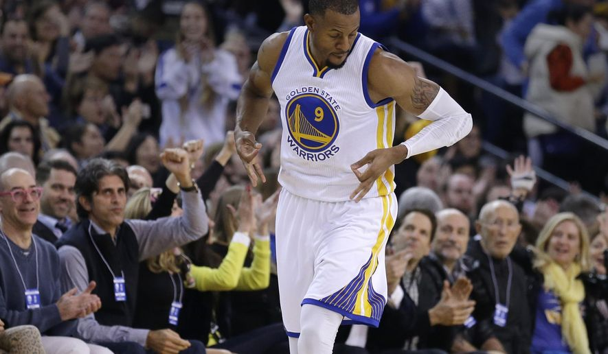 Golden State Warriors' Andre Iguodala celebrates after scoring against the Oklahoma City Thunder during the first half of an NBA basketball game Thursday, Dec. 18, 2014, in Oakland, Calif. (AP Photo/Ben Margot)