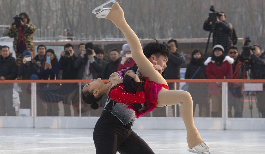 IN this Dec. 18, 2014 photo, figure skaters perform at the kick off ceremony for the Iceworld Sports Land skating park where Chinese sports officials attended to raise publicity for China's bid for the 2022 Winter Olympics in Beijing, China. Beijing is ramping up its bid for the 2022 Winter Olympics with series of international athletic competitions and promotional events, seeking to stir public support and cement its status as the front-runner to hold the games. (AP Photo/Ng Han Guan)