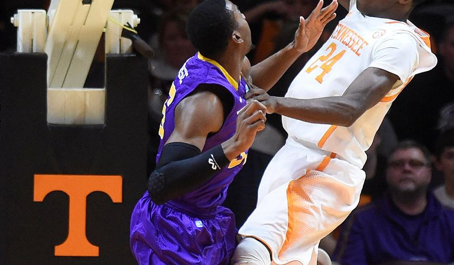 Tennessee forward Willie Carmichael III (24) dunks over Tennessee Tech forward Anthony Morse (35) during the second half of an NCAA college basketball game in Knoxville, Tenn. on Friday, Dec. 19, 2014. (AP Photo/Knoxville News Sentinel, Adam Lau)